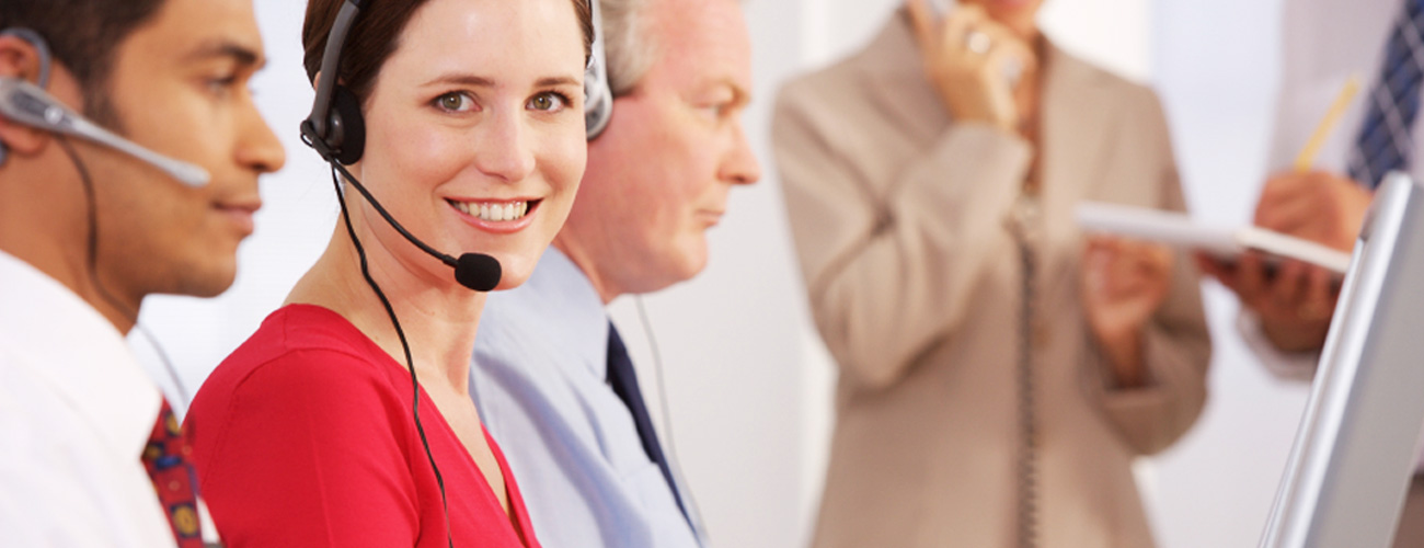 Smiling customer service rep with headset on