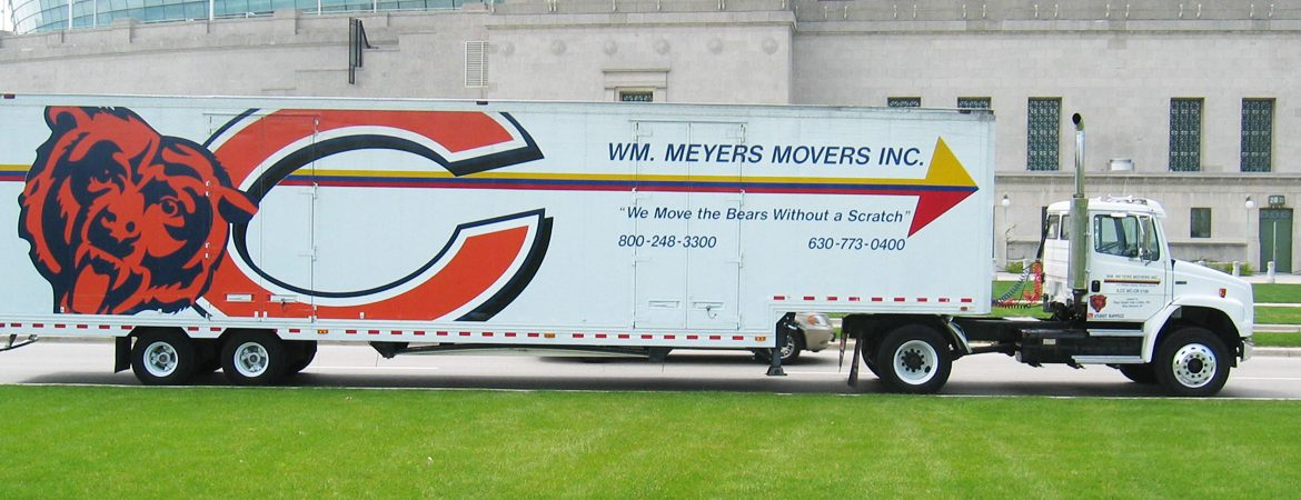 Meyers Movers truck in front of stadium